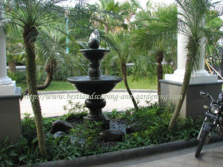 Water feature with stone pot